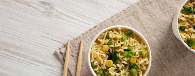 Quick cook noodle meal in a bowl with chopsticks