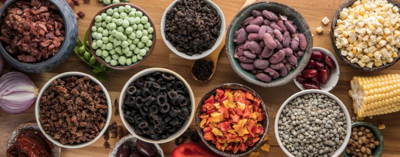 Selection of freeze dried vegetable and pulses presented in bowls